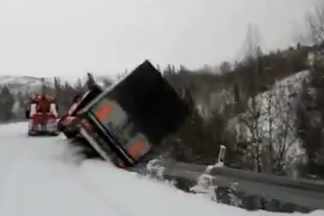 Truck falls off cliff - driver jumps