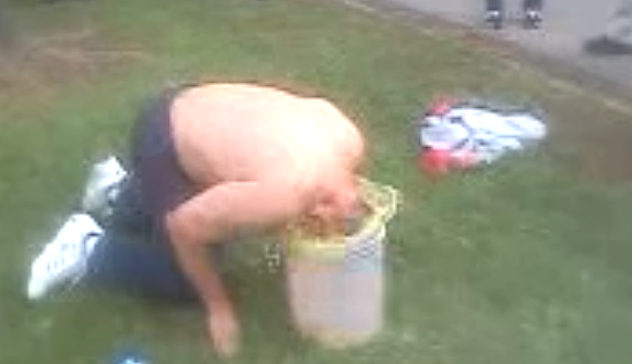 Guy sticks head in bucket of pee