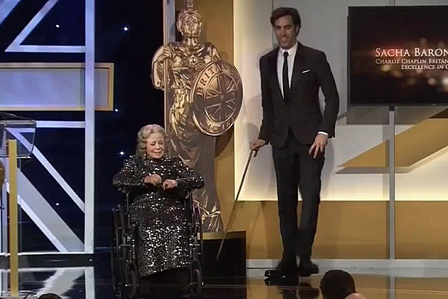 Sacha Baron Cohen Pushes Old Lady off stage
